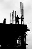 Silhouette labor working on building. Site Stock Photo