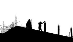 Silhouette labor working in construction site Stock Photos