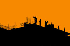 Silhouette labor working in construction site Stock Image