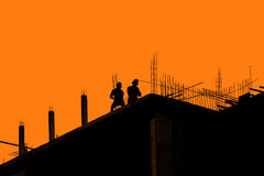 Silhouette labor working in construction site Stock Photography
