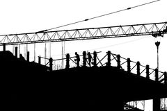 Silhouette labor working in construction site Royalty Free Stock Image