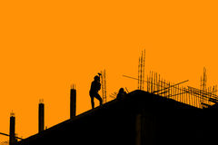 Silhouette labor working in construction site Stock Images