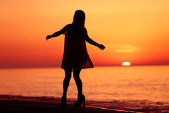Silhouette of a lady dancing Stock Photo