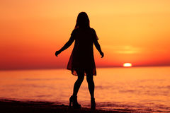 Silhouette of a lady dancing Stock Photography