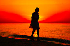 Silhouette of a lady dancing by the sea Royalty Free Stock Photo