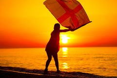 Silhouette of a lady dancing by the sea Stock Photo