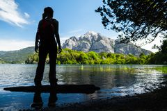 Silhouette of the lady hiker. Standing on the coast of a lake. Argentina royalty free stock photos