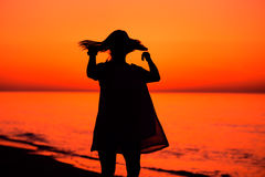 Silhouette of a lady waving her hair Stock Photo