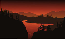 Silhouette of lake with brown backgrounds Royalty Free Stock Photography