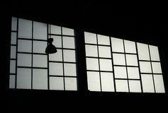 Silhouette lamp on glass window background Royalty Free Stock Photo
