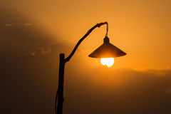 Silhouette of a lamp post at sunset Stock Photography