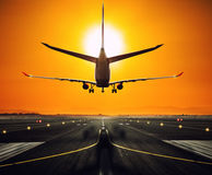 Silhouette from a landing airplane at the runway. Stock Image