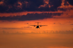Silhouette of a landing plane Royalty Free Stock Photo