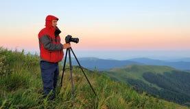 Silhouette of a landscape photographer Stock Photos