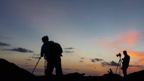 Silhouette of landscape photographers. Stock Photos