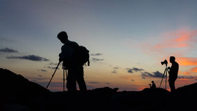 Silhouette of landscape photographers. Royalty Free Stock Image