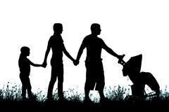 Silhouette of a large family that walks Stock Photo