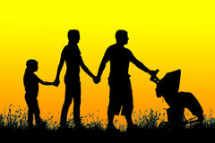 Silhouette of a large family that walks at sunset Stock Photography