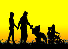 Silhouette of a large family that walks at sunset Royalty Free Stock Images