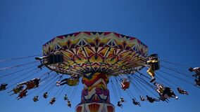 Wide angle view of large luna park spinning swing carousel