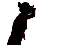 Silhouette of leaned forward woman Royalty Free Stock Image