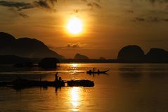 Silhouette Lifestyle Fisherman On Boat Fishing in Morning Golden Stock Photography
