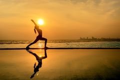Silhouette lifestyle healthy woman practicing yoga Royalty Free Stock Photos