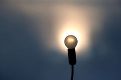 Silhouette of the light bulb in setting sun. The silhouette of the light bulb in setting sun Stock Images