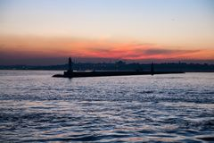 Silhouette of the lighthouse on the sunset on the Bosphorus, Istanbul, Turkey stock images