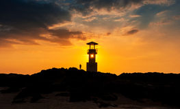 Silhouette of lighthouse at sunset Royalty Free Stock Images