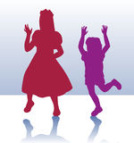 Silhouette of little boy and girl Stock Images