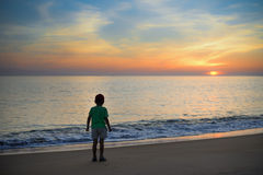 Silhouette of little boy standing alone on Royalty Free Stock Photography