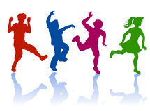 Silhouette of little boys and girls. Boys and girls dancing and playing together Royalty Free Stock Photography