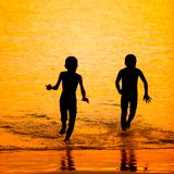Silhouette little child on a beach Royalty Free Stock Image