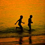 Silhouette little child on a beach Stock Images
