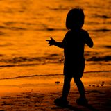 Silhouette  little  child on a beach Royalty Free Stock Photos