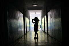 Silhouette of the little girl. In a long corridor Royalty Free Stock Image