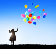 Silhouette of a Little Girl with Balloons Royalty Free Stock Photography