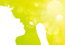 Silhouette of a little girl blowing dandelion on a green bokeh b Royalty Free Stock Photo