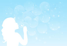 Silhouette of a little girl blowing dandelion. Stock Photography