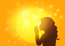 Silhouette of a little girl blowing soap bubbles Stock Photo
