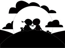 Silhouette of little girl and boy Royalty Free Stock Photo