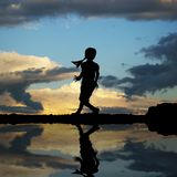 Silhouette of a little girl jumping Royalty Free Stock Image