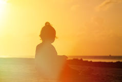 Silhouette of little girl looking at sunset Stock Photography
