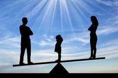 Silhouette little sad girl crying standing between mom and dad, chooses to stay with dad royalty free stock photography