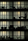Silhouette living. Urban living at night - modern architecture silhouette Royalty Free Stock Image