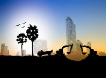Silhouette  Loaders and trucks in a construction site over Blurr. Ed construction site Royalty Free Stock Photography
