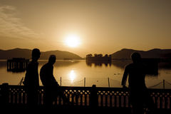 Silhouette of local Indian young boys in the palace Jal Mahal Stock Image