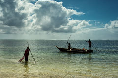 Silhouette of local people in Zanzibar going to fish Stock Photos