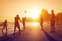 Silhouette of Locals Playing Ball at Sunset in Ipanema Beach, Rio de Janeiro, Brazil Stock Image
